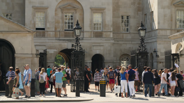 pan right across tourists outside horse guards - british military stock videos & royalty-free footage