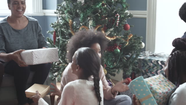 pan right, african american family on christmas morning - gift stock videos & royalty-free footage
