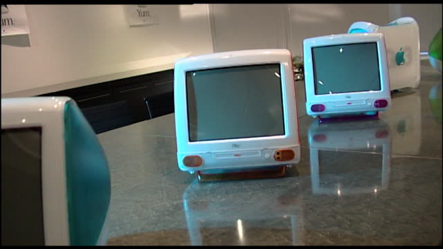 pan right along a row of imac g3 computers with colourful backs 1999 - 1999 stock videos & royalty-free footage