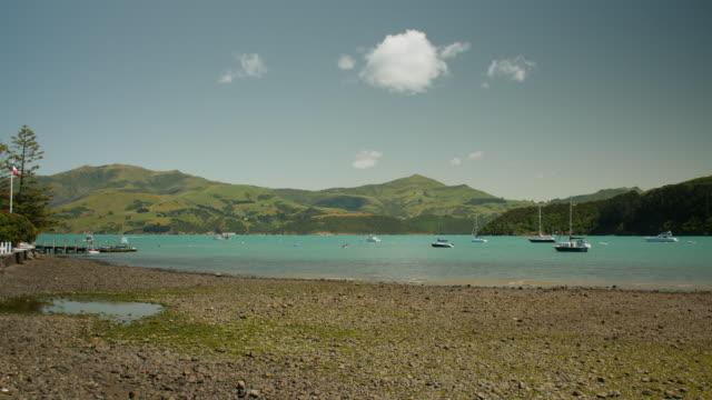pan right around akaroa harbour - akaroa stock videos & royalty-free footage