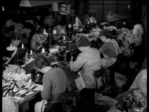 Pan right around Liverpool factory with women making flags for Coronation of Queen Elizabeth II Jan 53