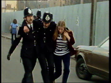 pan right as injured police officer is carried away by fellow officers during rioting in brixton london; apr 81 - 1981 stock videos & royalty-free footage