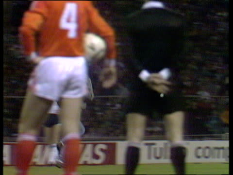 Pan right as intruder runs onto pitch and pretends to score goal during international friendly England vs Holland Wembley Stadium London 23 Mar 88