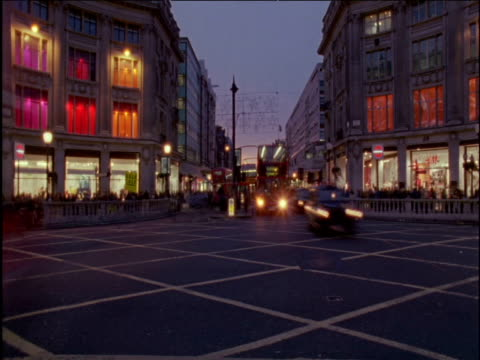 pan right as people and traffic pour across oxford circus london - oxford circus stock videos and b-roll footage