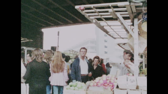 pan right atlantic road market under railway arches; brixton, 1973 - elevated train stock videos & royalty-free footage