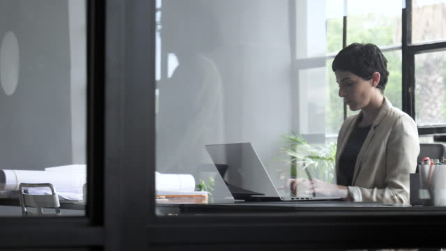 pan right, caucasian woman types in office - multiple exposure stock videos & royalty-free footage
