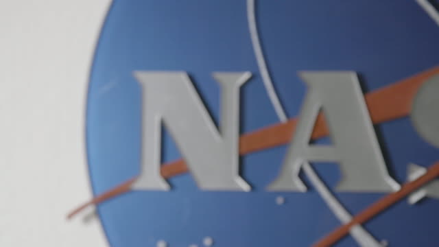 Pan right, close up of NASA sign