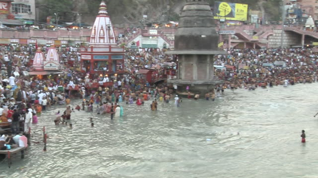 pan right crowded haridwar banks uttarakhand - water's edge stock videos & royalty-free footage