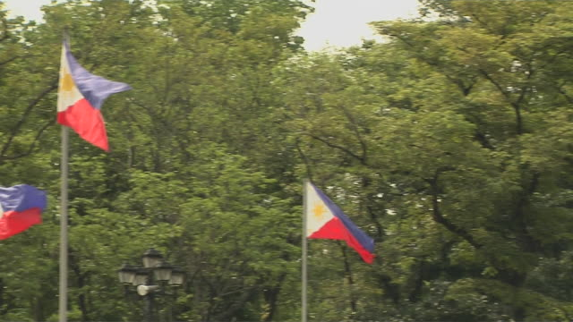 pan right flag rost rizal park manila philippines - philippines flag stock videos & royalty-free footage