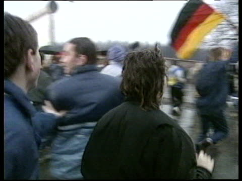 pan right following jubilant crowd surging through border crossing at brandenburg gate opening of berlin wall 22 dec 89 - bbc archive stock-videos und b-roll-filmmaterial