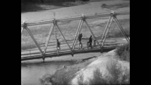 pan right following people crossing the the river jordan after the arab-israeli conflict; 1967. - 1967 stock videos & royalty-free footage