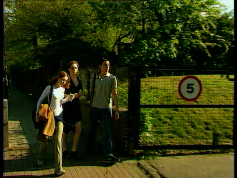 pan right following young voters entering polling station in putney 1997 general election 01 may 97 - wahllokal stock-videos und b-roll-filmmaterial