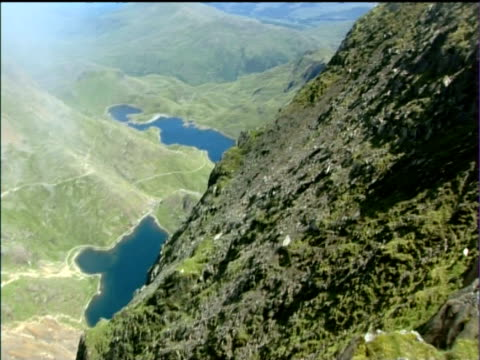pan right from lakes up side of mount snowdon to peak and viewing platform snowdonia national park - snowdonia stock videos & royalty-free footage