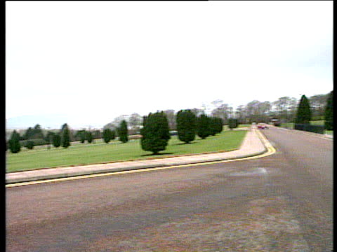 pan right from lawns and driveway to stormont building belfast - stormont stock videos and b-roll footage