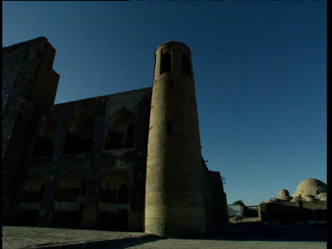 pan right from miri arab madressah to domed rooftops of bukhara uzbekistan - bukhara stock videos & royalty-free footage