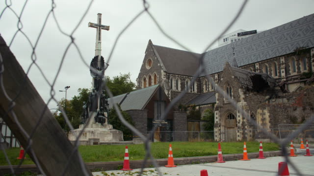 Pan right from the damaged Citizens' War Memorial to the remains of the Christchurch Cathedral