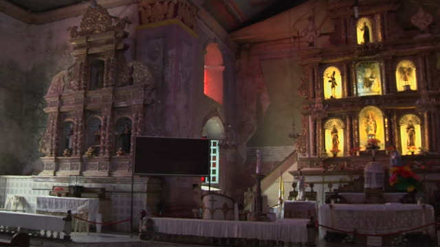 pan right interior shot church baclayon bohol philippines - tischtuch stock-videos und b-roll-filmmaterial