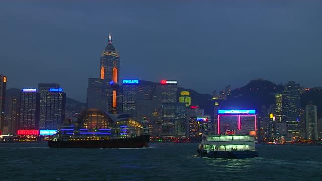 pan right night shot skyline aberdeen harbour hong kong kwangtung china - aberdeen hong kong stock videos & royalty-free footage