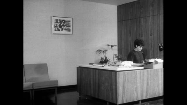 pan right of office to woman typing at desk; 1963 - 1963 stock videos & royalty-free footage