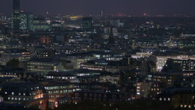 pan right onto a wide view of london's skyline, uk. - residential district stock videos & royalty-free footage