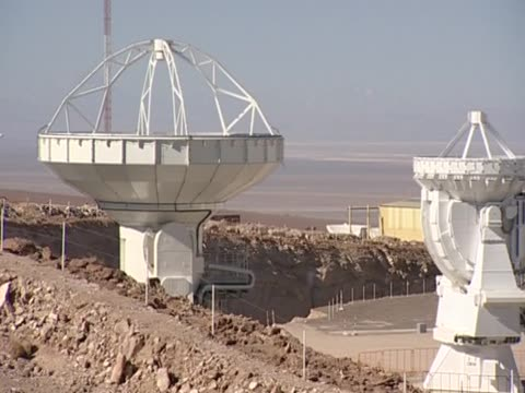 pan right over antennas that make up alma the world's most powerful telescope chile - atacama large millimeter array stock videos and b-roll footage