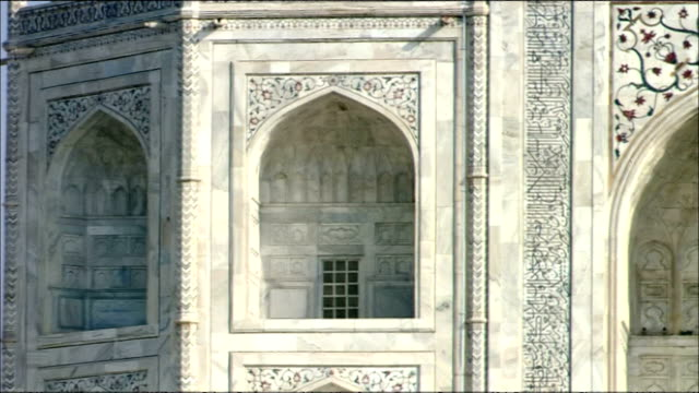 pan right over arches of taj mahal, agra - stone material stock videos & royalty-free footage