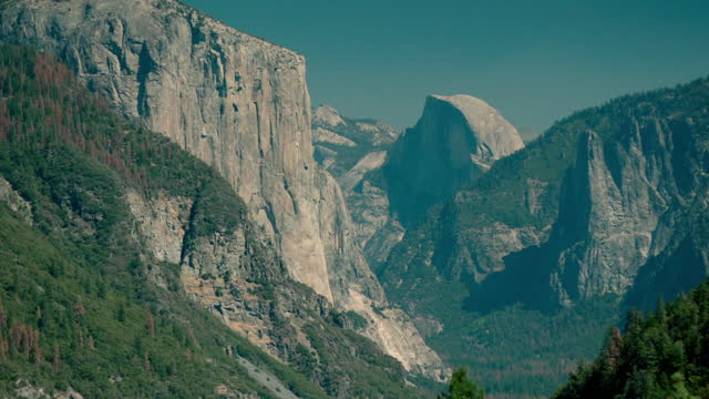 pan right over dramatic rock formations, yosemite, us - national landmark stock videos & royalty-free footage