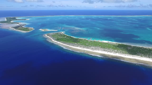 pan right over entire kanton atoll - micronesia stock videos & royalty-free footage