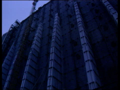 pan right over exterior of concrete sarcophagus covering damaged chernobyl nuclear power station reactor chernobyl; 1991 - nuclear reactor stock videos & royalty-free footage