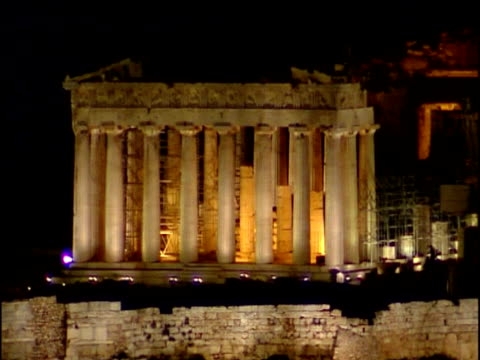 pan right over floodlit parthenon with scaffolding athens - doric stock videos & royalty-free footage