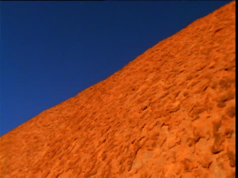 pan right over glowing red sandstone of olgas in outback, northern territory, australia - sandstone stock videos & royalty-free footage