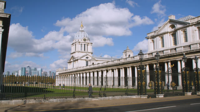 pan right over grounds of the old royal naval college in greenwich with the isle of dogs in the background - royal navy college greenwich stock videos & royalty-free footage