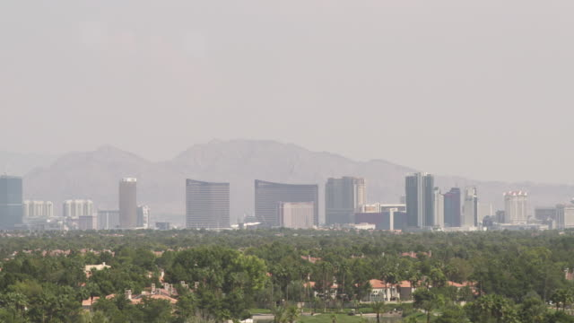 pan right over hotels and casinos of las vegas as seen from a residential district, nevada, usa. - casino stock videos & royalty-free footage