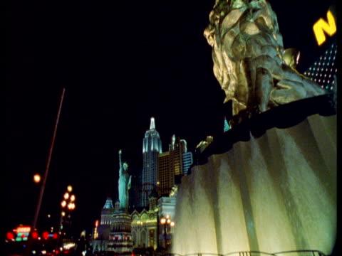 pan right over lion fountain, las vegas - casino stock videos & royalty-free footage