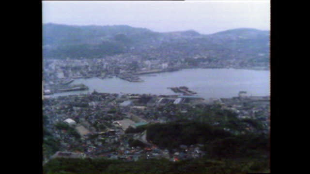 pan right over nagasaki city and harbour; 1981 - nuclear bomb stock videos & royalty-free footage