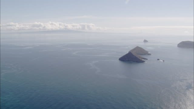 Pan right over ocean to islands Galapagos Islands Available in HD.