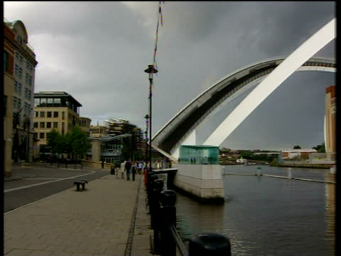 pan right over river tyne to baltic arts centre with gateshead millennium bridge raised in foreground to allow clear passage newcastle - tyne bridge stock videos & royalty-free footage