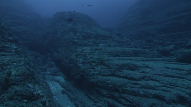 pan right over rock outcrops of yonaguni monument. japan - mystery stock videos & royalty-free footage
