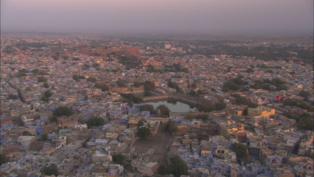 Pan right over rooftops of vast city at sunset Jaipur Rajasthan Available in HD.