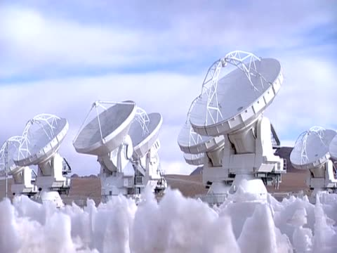 pan right over the array of antennas of alma the world's most powerful telescope high up in the atacama desert - atacama large millimeter array stock videos and b-roll footage