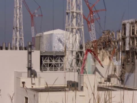 pan right over the fukushima power plant - akw reaktorbereich stock-videos und b-roll-filmmaterial