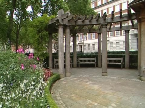 stockvideo's en b-roll-footage met pan right over the grovesnor square memorial memorial to all the british victims killed in the 9/11 terrorist attack in new york london - number 9