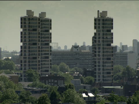 pan right over tower blocks in residential area london - housing development stock videos & royalty-free footage