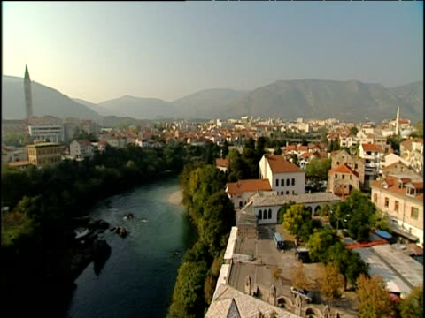 pan right over town of mostar with mountains in distance - bosnia and hercegovina stock videos & royalty-free footage