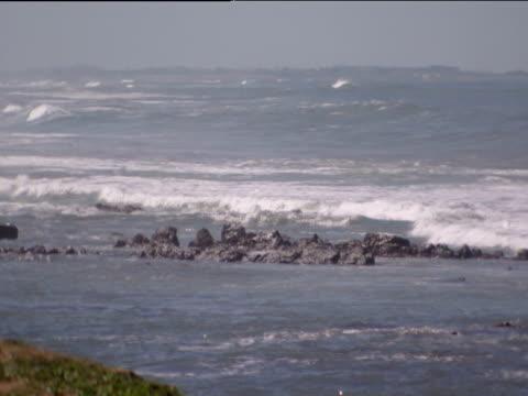 pan right over waves casablanca - küste stock-videos und b-roll-filmmaterial