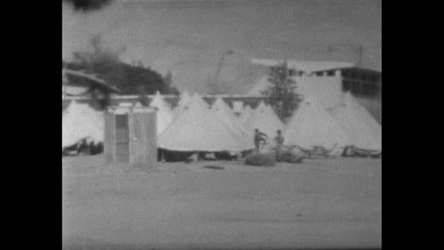 pan right over white tents set up in a refugee camp near the river jordan and amman for people fleeing conflict in the arab-israeli war; 1967 - 1967 stock videos & royalty-free footage