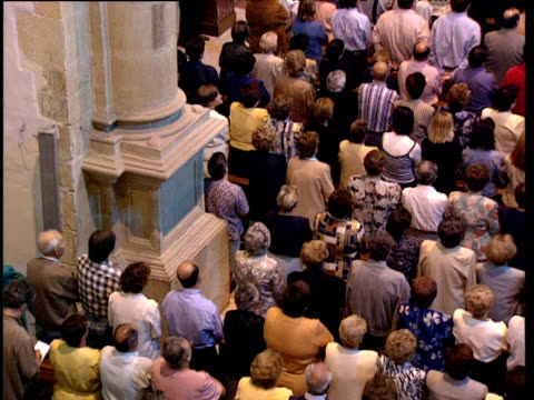 Pan right over worshippers singing during mass Basque Country Spain