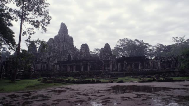 pan right past angkor thom. - damaged stock videos & royalty-free footage