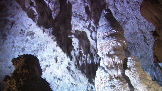 pan right past limestone formations available in hd. - calcare video stock e b–roll