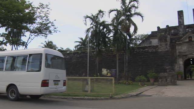 pan right reveal fort san pedro cebu bohol philippines - tree fort stock videos & royalty-free footage